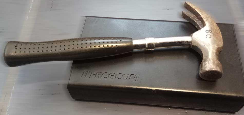 Shucking a Freecom external hard drive using a hammer